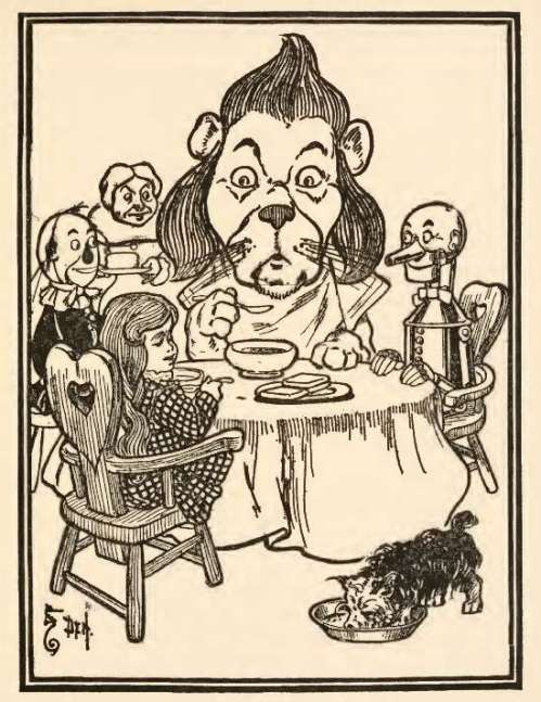 cowardly-lion-and-others at-the-table-eating